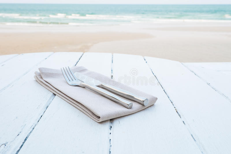 Table setting at beach restaurant royalty free stock image