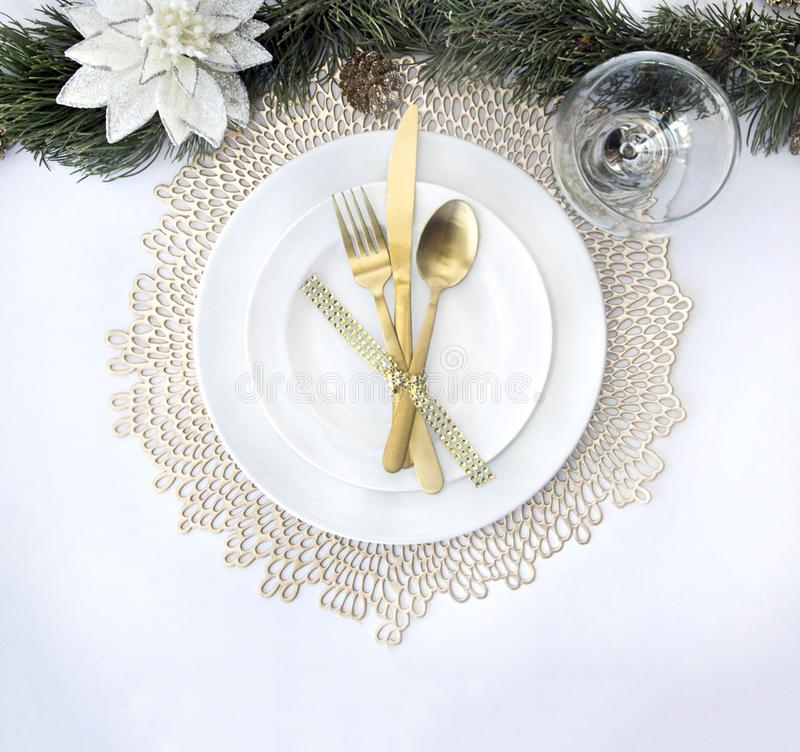 Gold silverware and table setting for christmas royalty free stock image