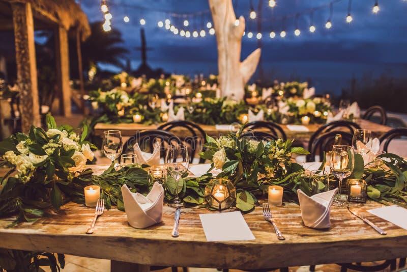 Table setting decoration at night wedding ceremony stock photo