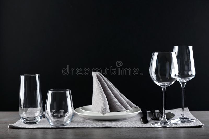 Table setting with empty glasses, plates and cutlery on table royalty free stock photos