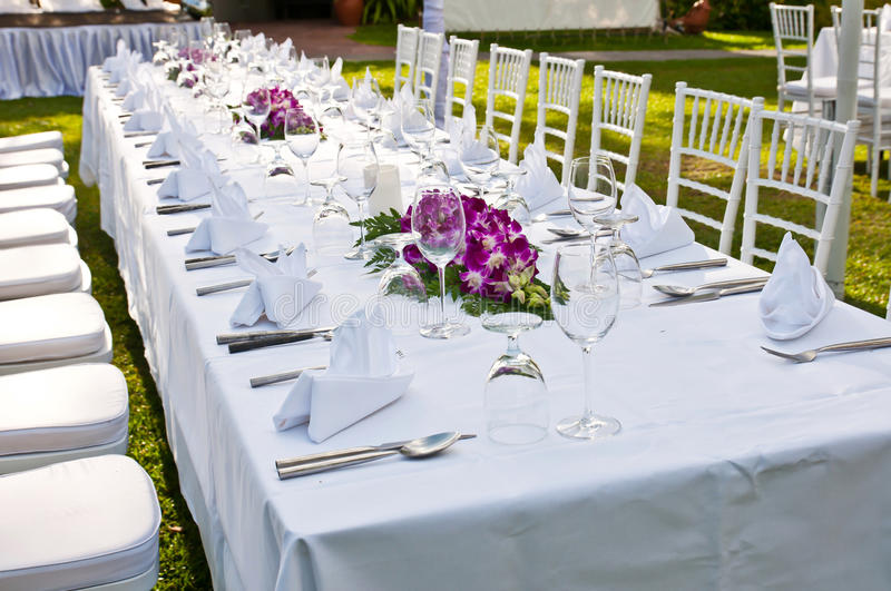 Table setting for an event party or wedding reception on sunset stock image