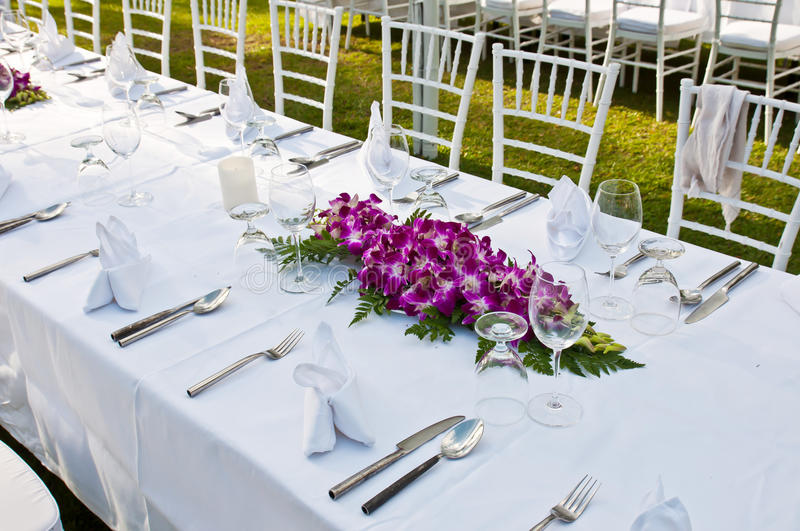 Table setting for an event party or wedding reception on sunset royalty free stock photos