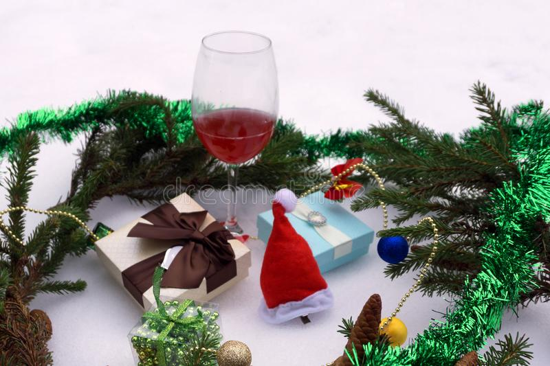 Table setting with gift and white wine ready for Christmas day.  stock image