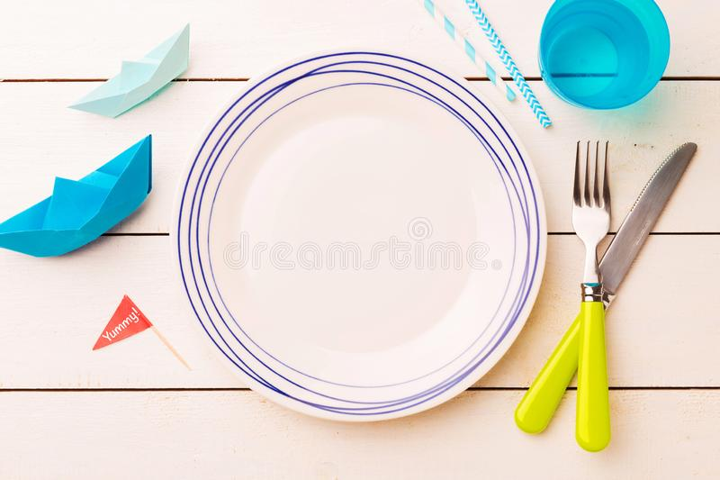 Table setting for kids - empty plate with decorations around stock images