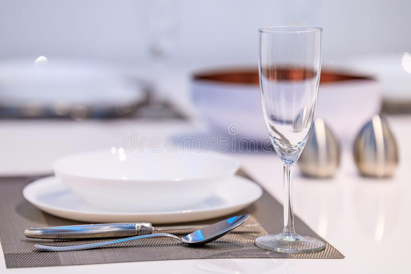 Table setting in a modern dining room royalty free stock photography