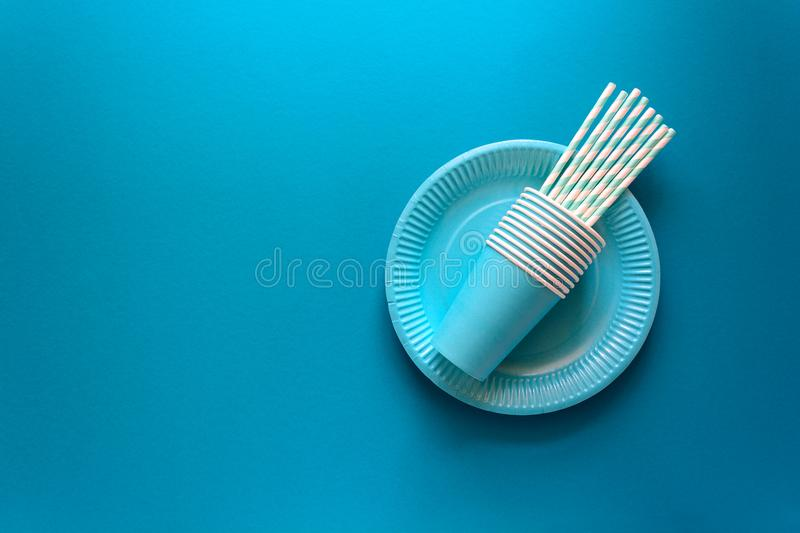 Table setting with paper ware for summer picnic or BBQ. Top view. Flat lay stock image