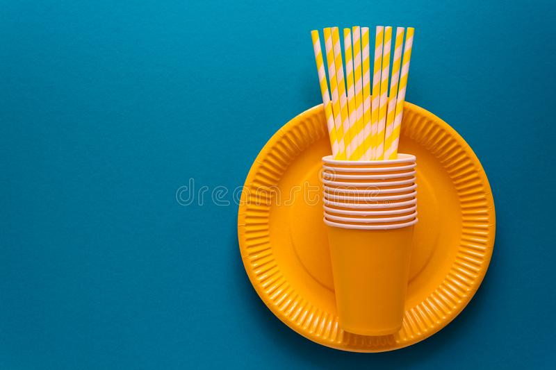 Table setting with paper ware for summer picnic or BBQ. Top view. Flat lay stock photo