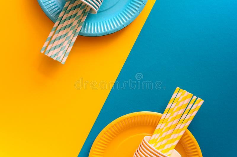 Table setting with paper ware for summer picnic or BBQ. Top view. Flat lay stock images