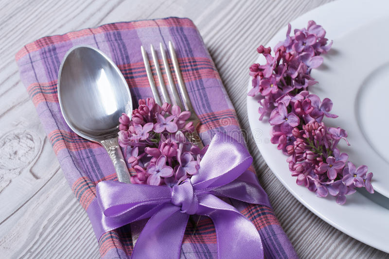 Table setting in purple colors, decoration flowers lilacs stock photo