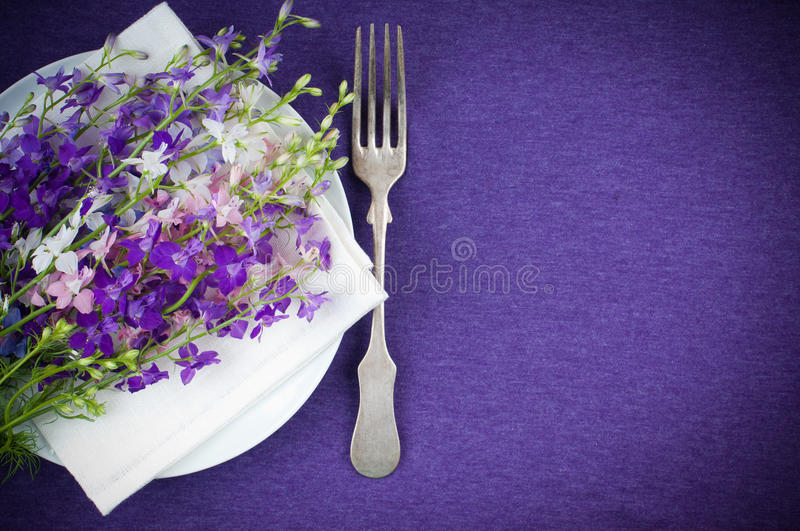 Download Table Setting With Purple Flowers Stock Photo - Image: 24881666