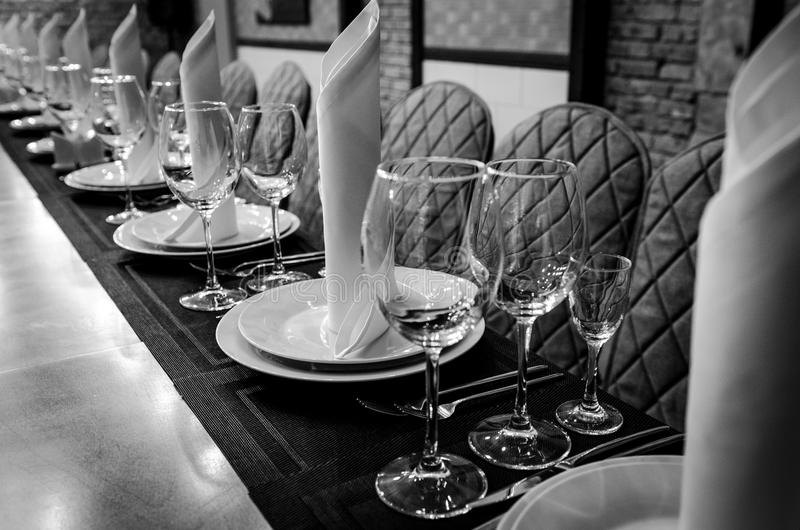 Empty glasses in restaurant. Table setting for dinner royalty free stock photography