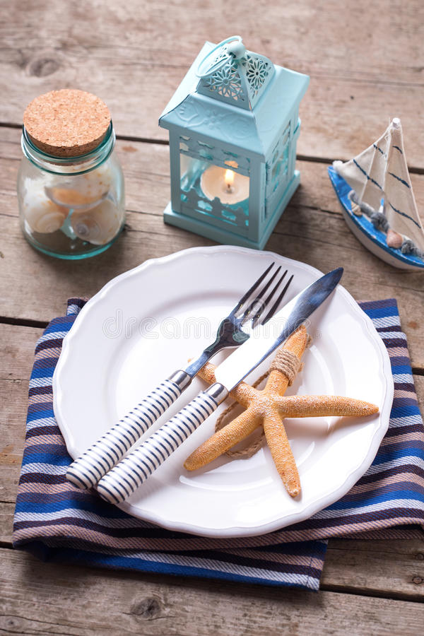 Table setting for summer, sea theme. Blue and white. Selective focus. Vertical image royalty free stock photos