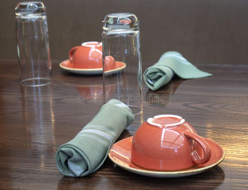 Table setting for two - Landscape; focus on front cup stock photos