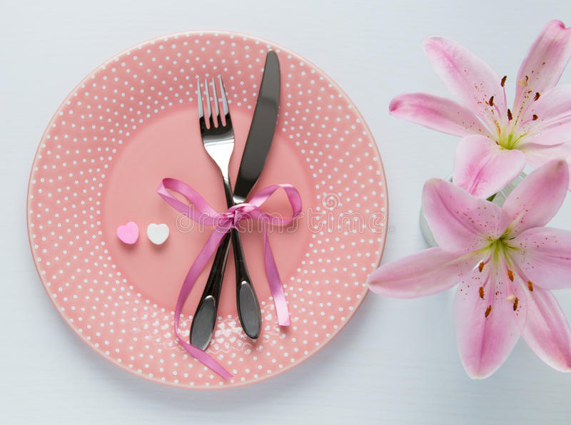 Table setting for Valentines Day. Table setting for Valentines Day in pink color. Top view stock image