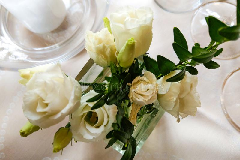 Table setting for a wedding or dinner event, with flowers royalty free stock image