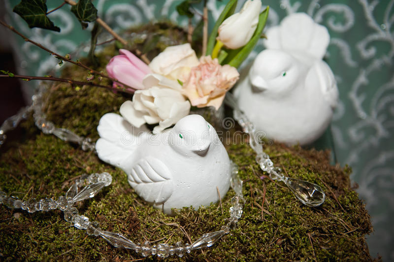 Table setting for wedding or event with doves. Table setting for wedding or other event with artificial doves royalty free stock photography