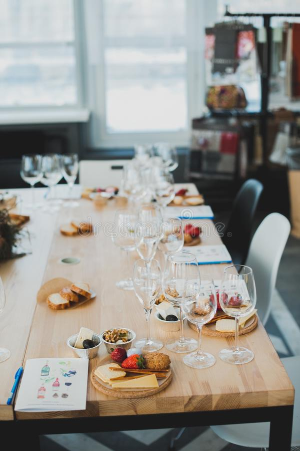 Table setting with wine and snacks, etiquette and event. Table setting with wine and snacks, etiquette royalty free stock photos