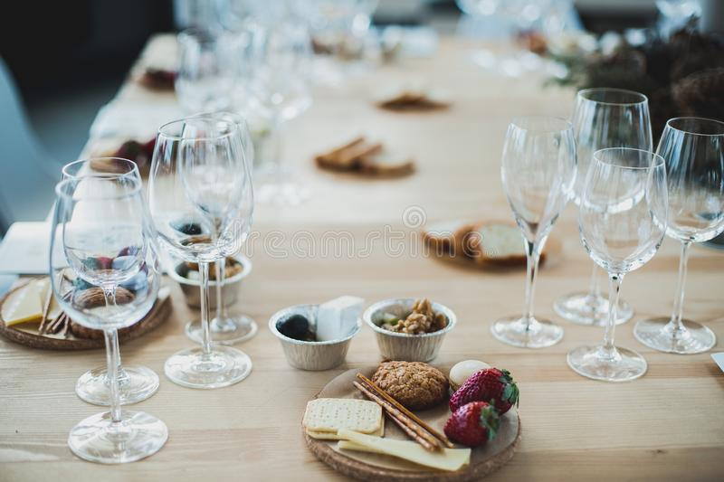 Table setting with wine and snacks, etiquette and event. Table setting with wine and snacks, etiquette stock photos