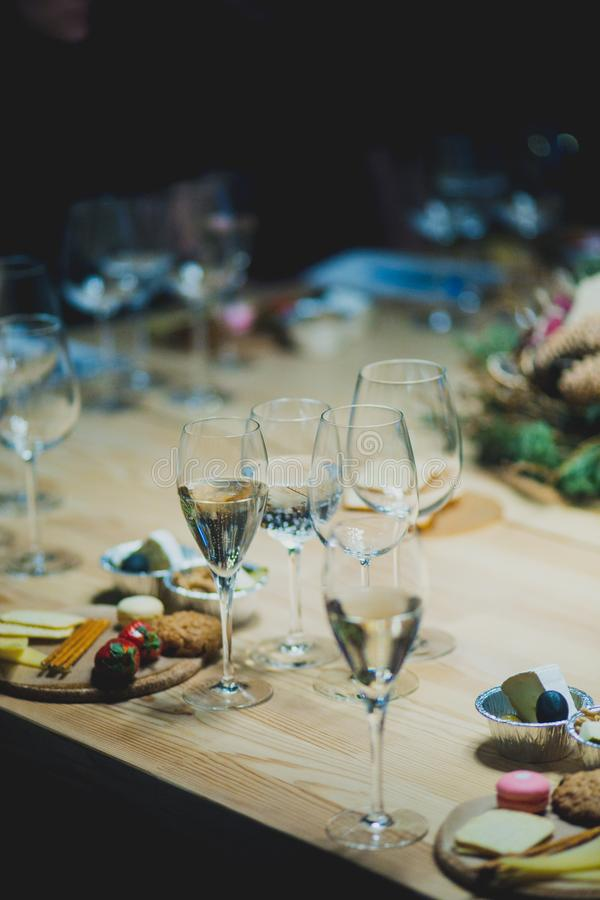 Table setting with wine and snacks, etiquette and event. Table setting with wine and snacks, etiquette stock images