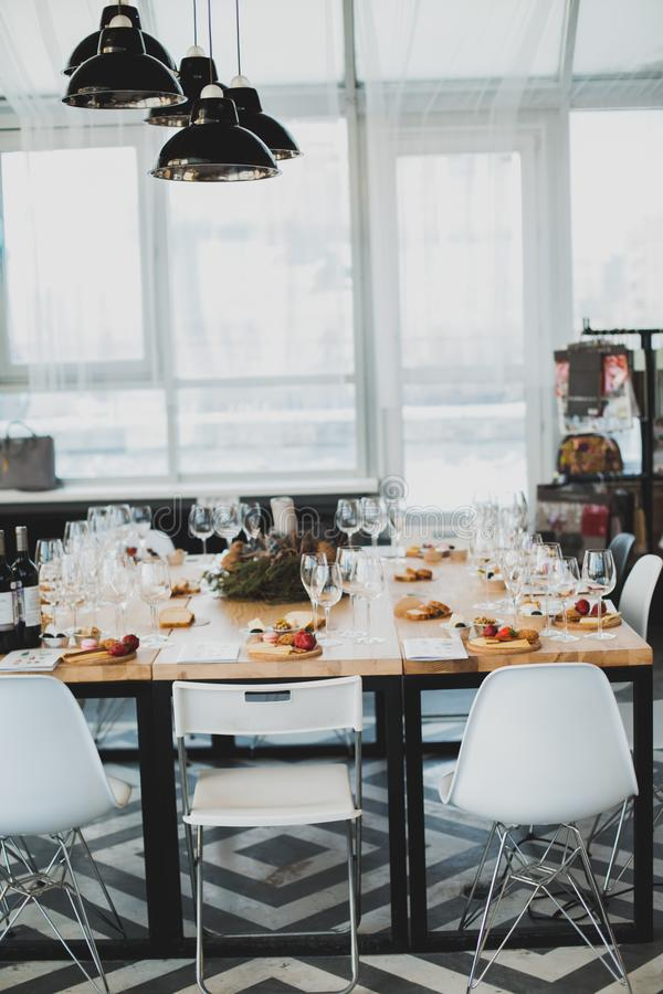 Table setting with wine and snacks, etiquette and event. Table setting with wine and snacks, etiquette royalty free stock images