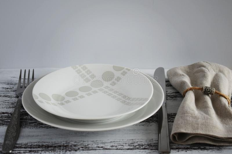 Table setting on wooden rustic dinning table for one person royalty free stock images