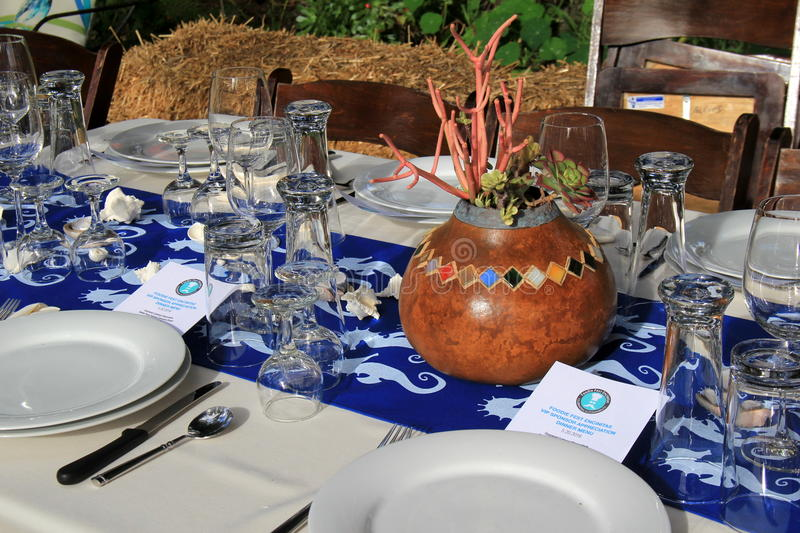 Table settings for dinner with folks attending benefit dinner, Foodie festival Encinitas, California, 2016. Beautiful table setting for dinner with folks stock photos