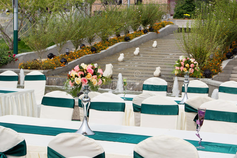 Table settings for wedding or event party outdoor at park. Table settings for wedding guests. Decorated tables and chairs for event party outdoor at the park royalty free stock images