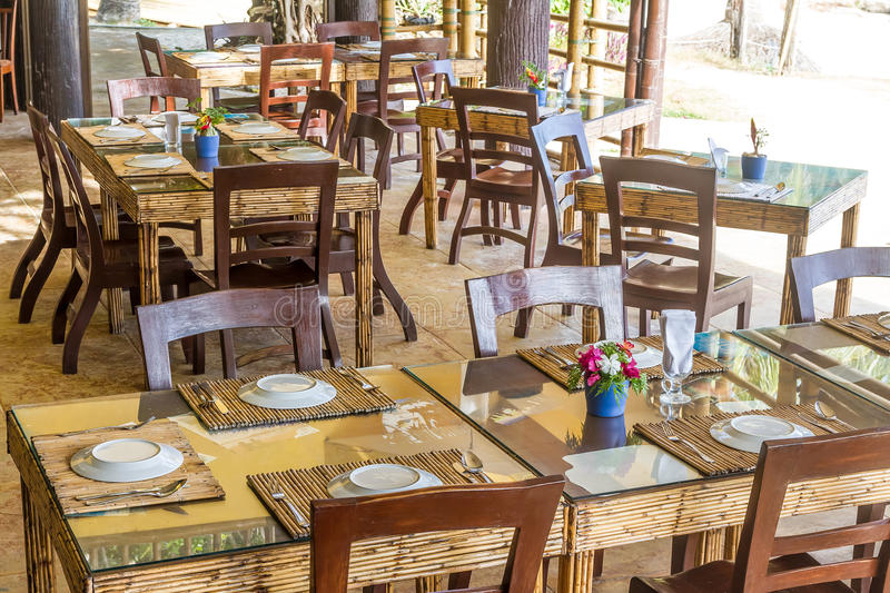 Table setup in outdoor cafe small restaurant a hotel