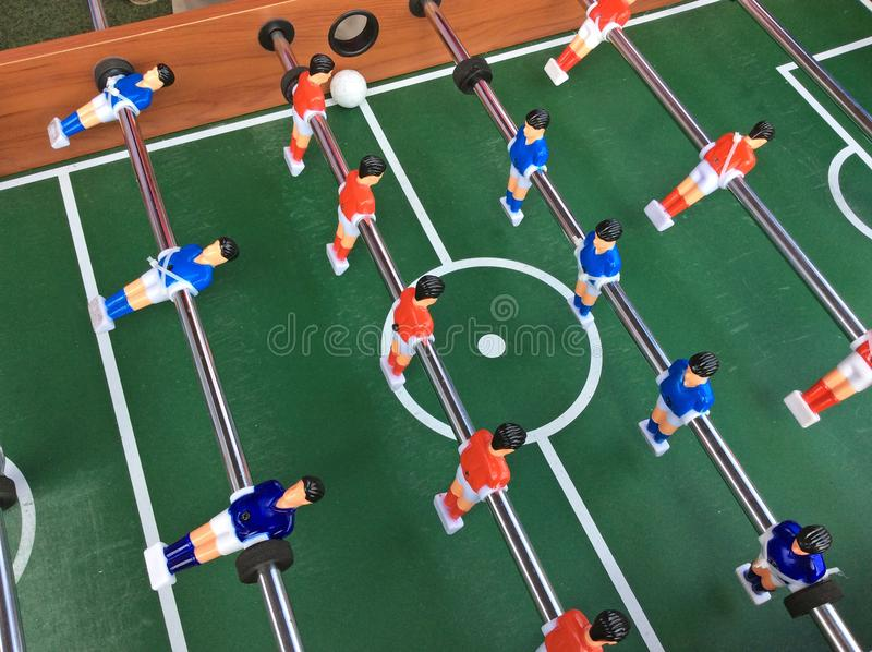 Table soccer game. Pitch and players stock image