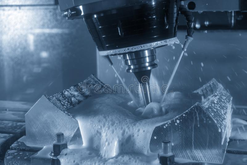 The table spindle tilt type 5-axis CNC milling machine. Cutting the rubber tire mold part with solid ball endmill in the light blue scene stock photo