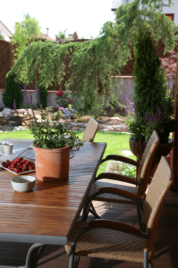 Download Table In Summer Garden Royalty Free Stock Images - Image: 6423459
