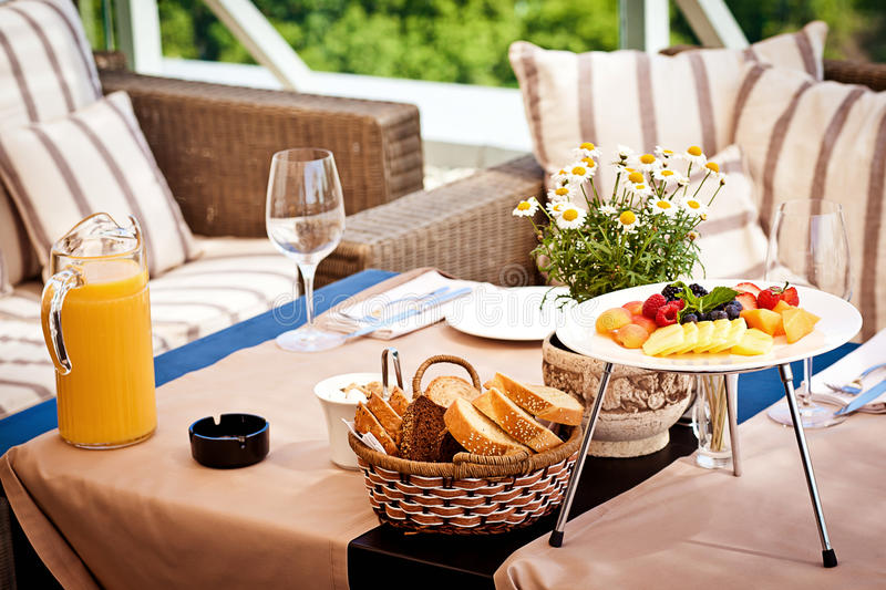 Table at summer terrace royalty free stock photography
