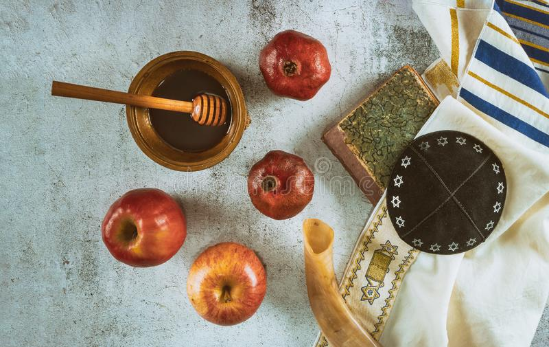 On the table in the synagogue are the symbols of Rosh Hashanah apple and pomegranate, shofar talith. Table in the synagogue are symbols of Rosh Hashanah apple stock photo