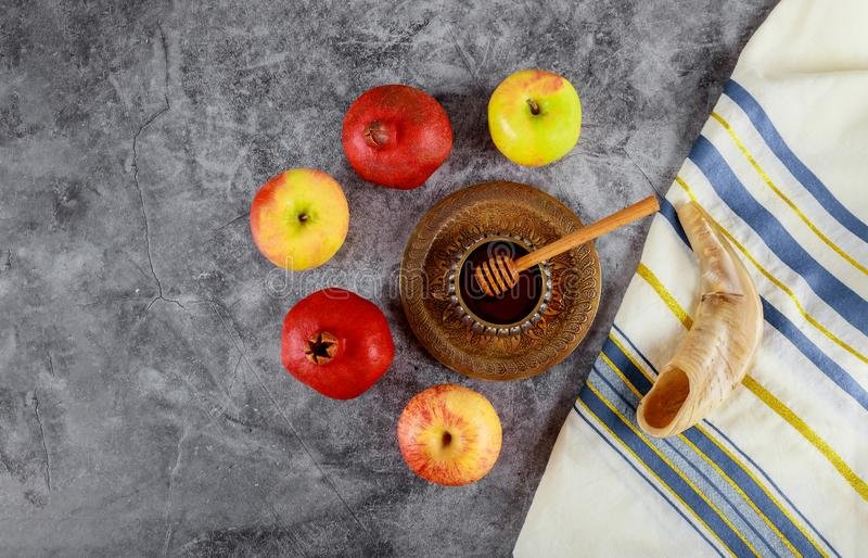 On the table in the synagogue are the symbols of Rosh Hashanah apple and pomegranate, shofar talith. Synagogue of Rosh Hashanah apple and pomegranate, shofar stock photos