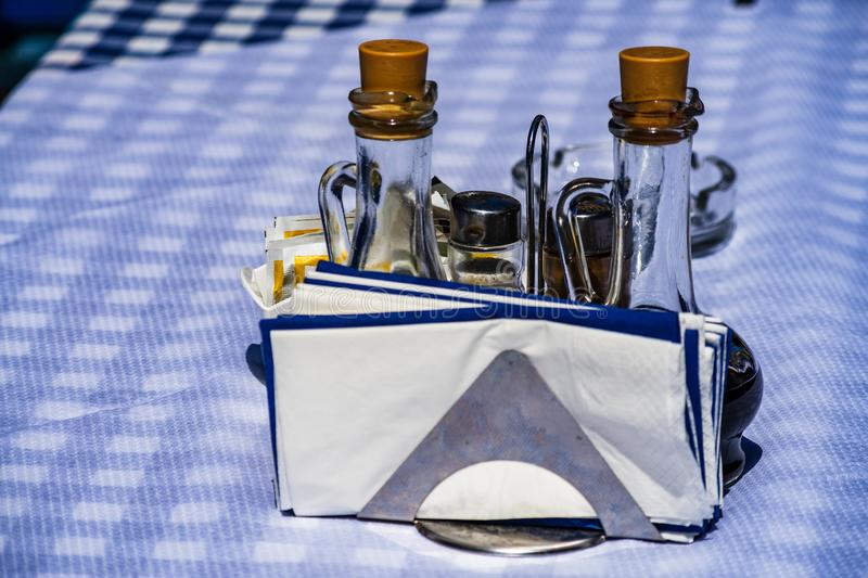 A table with a tablecloth at a Greek taverna. In Greece royalty free stock images