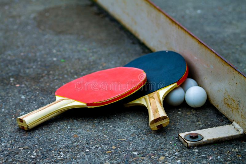 Table tennis bats. Table tennis bats left after a match with all balls ready for the next game royalty free stock images