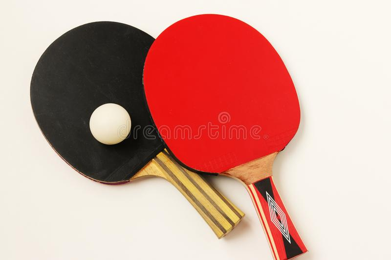 Table tennis bats. Tennis rackets are arranged on a white background, top view. Sport activities royalty free stock image