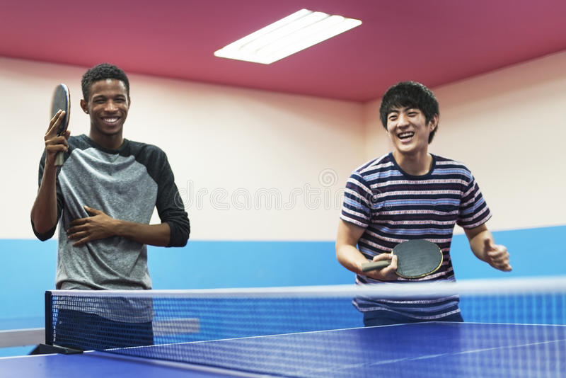 Table Tennis Ping-Pong Friends Sport Concept stock images
