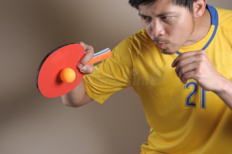Table Tennis player hit Ping-Pong ball royalty free stock photo
