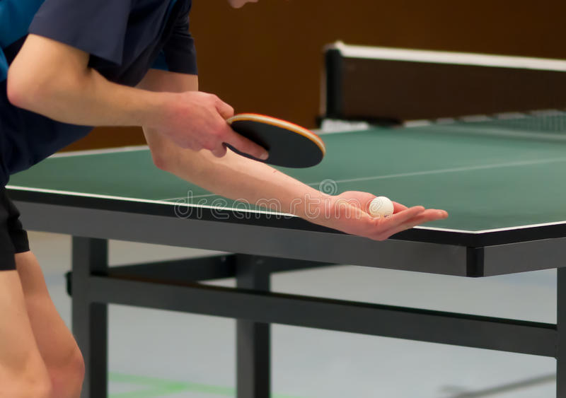 Table tennis player serving royalty free stock photo