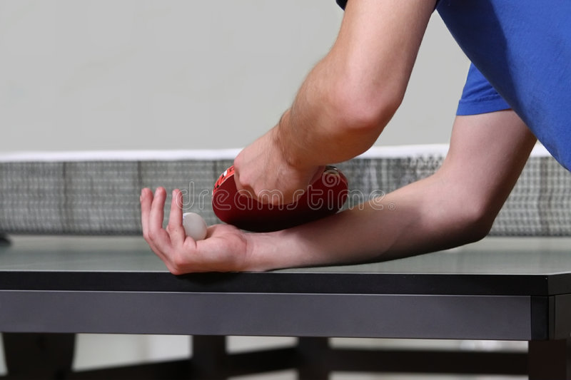 Table tennis player serving royalty free stock images