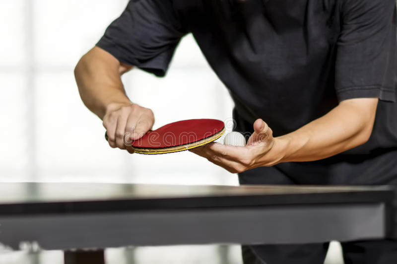 Table tennis player serving royalty free stock photography