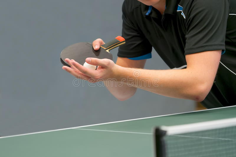 Table tennis player serving. Close up of a table tennis player serving royalty free stock photography