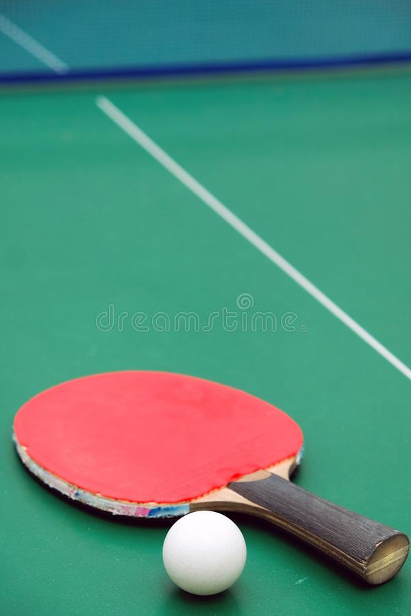 Table tennis racket with a ball royalty free stock image