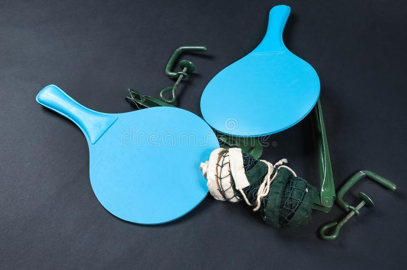 Table tennis racket and net. On dark background stock photography