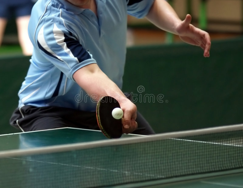 Table tennis returning. Close up of a table tennis player returning the ball stock photos