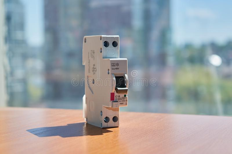 On the table there is an automatic switch of differential current in a compact design. stock images