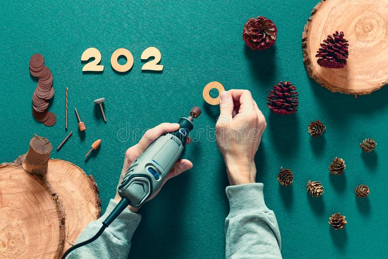 On the table there is a production of wooden figures for the celebration of the new year and Christmas using an electric engraver stock photos