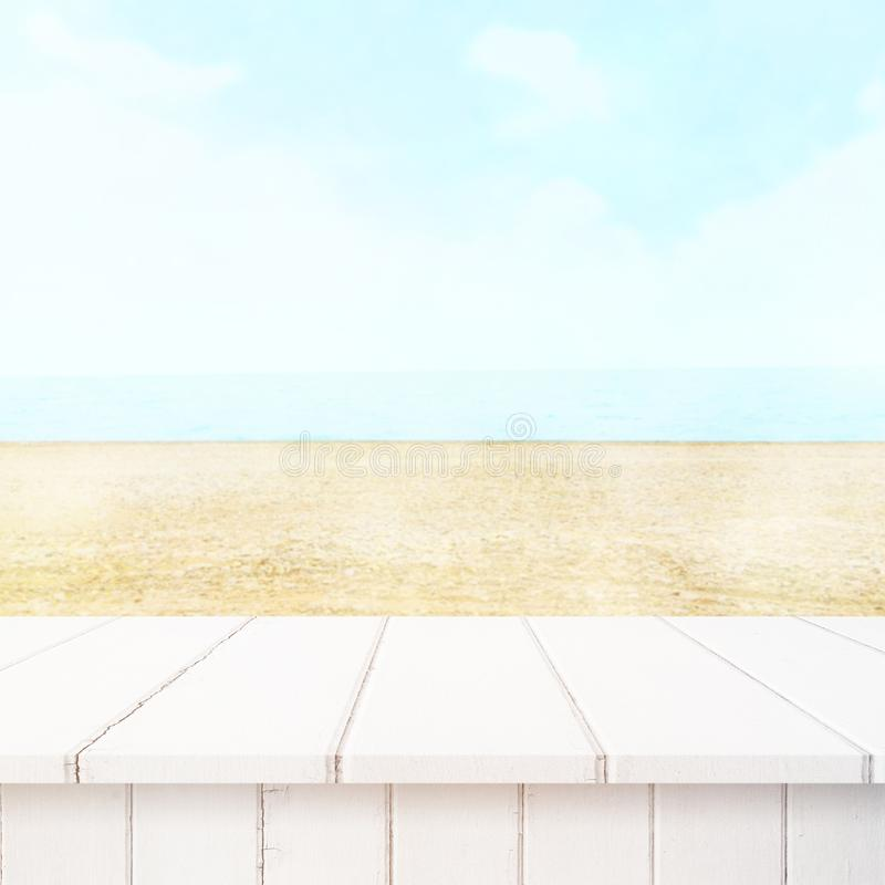 Table top with beach background, sky and cloud in sunny day for product display job showing. stock photography