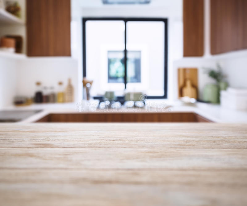 table top with blur kitchen pantry home background stock